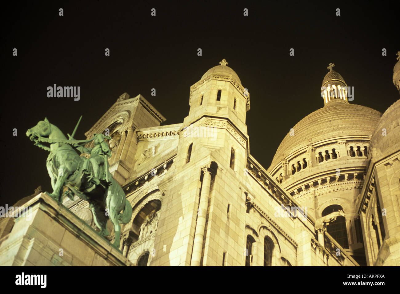 Night view of the Basilica of the Sacred Heart of Paris, commonly known as Sacré-Cœur Basilica and often simply Sacré-Cœur - Stock Image