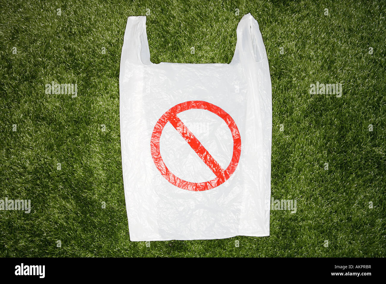 A plastic bag with a warning sign on it - Stock Image
