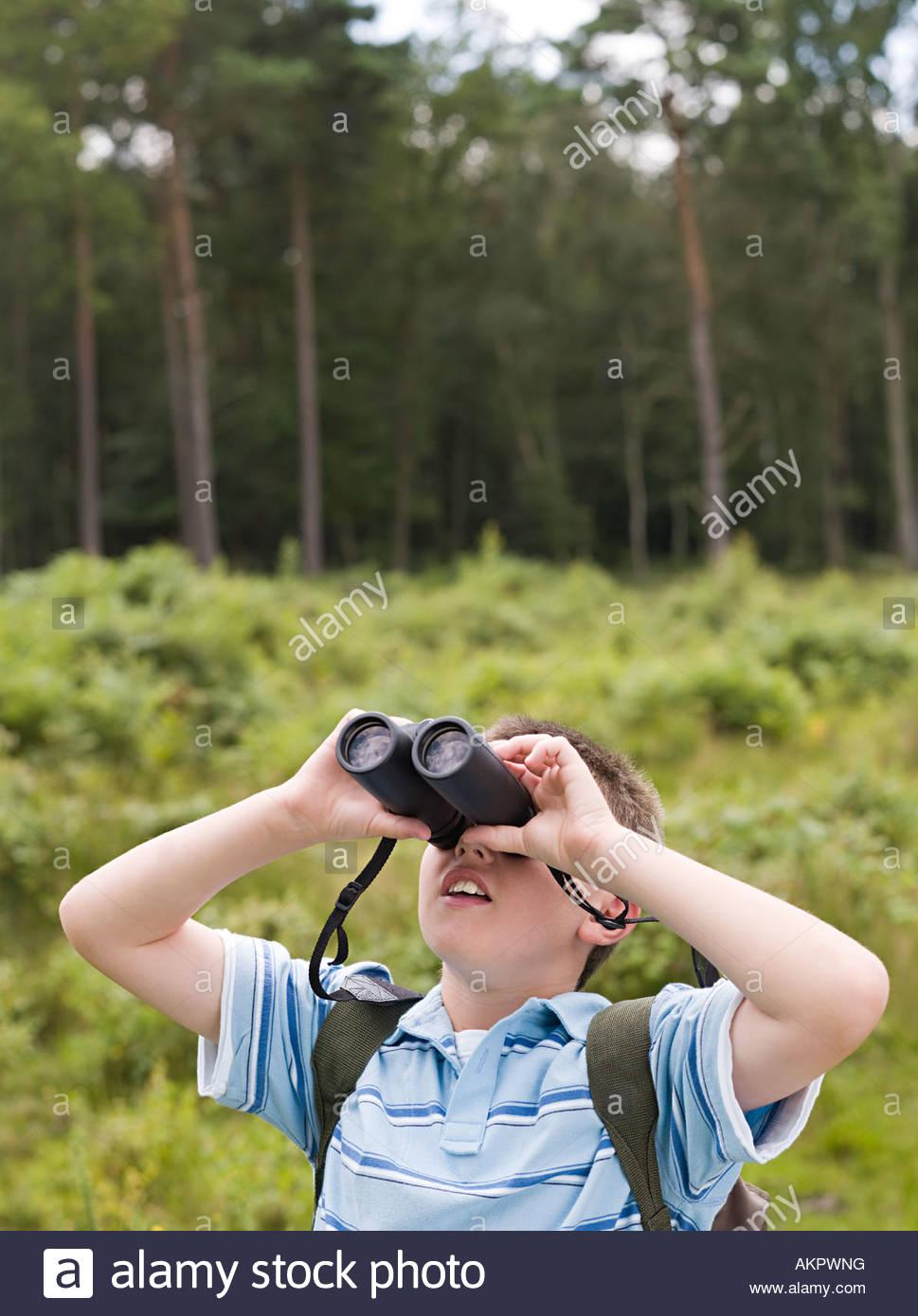 Boy with binoculars - Stock Image