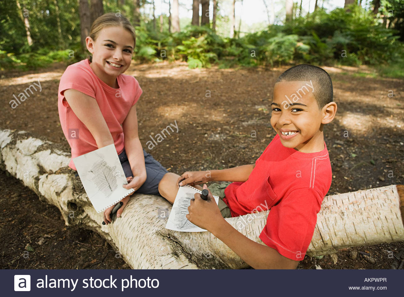 Boy and girl with drawings - Stock Image