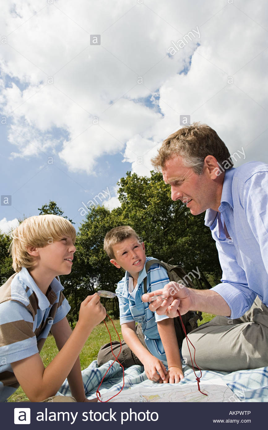 Teacher and pupils on field trip - Stock Image