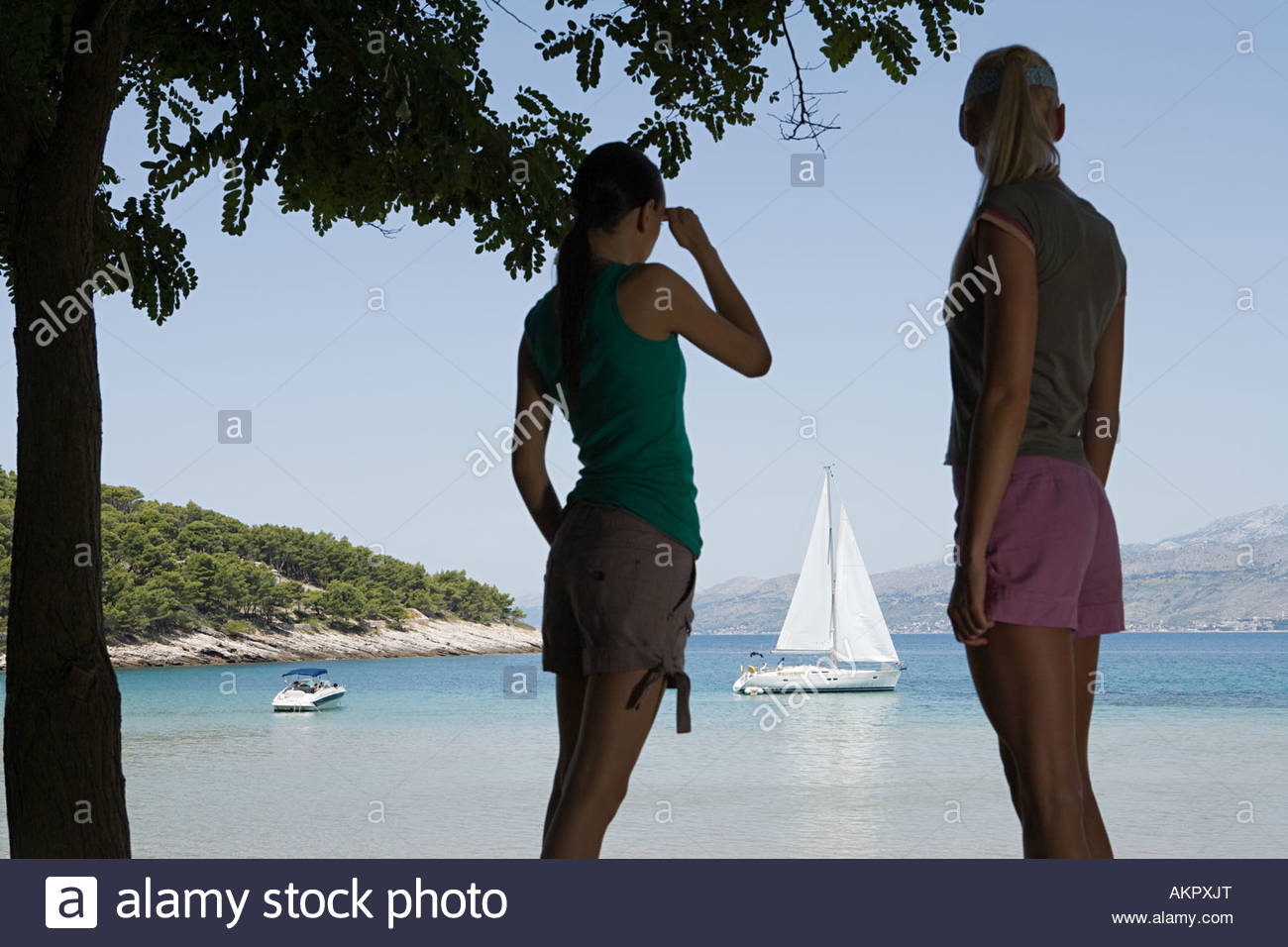 Friends stood in the shade - Stock Image