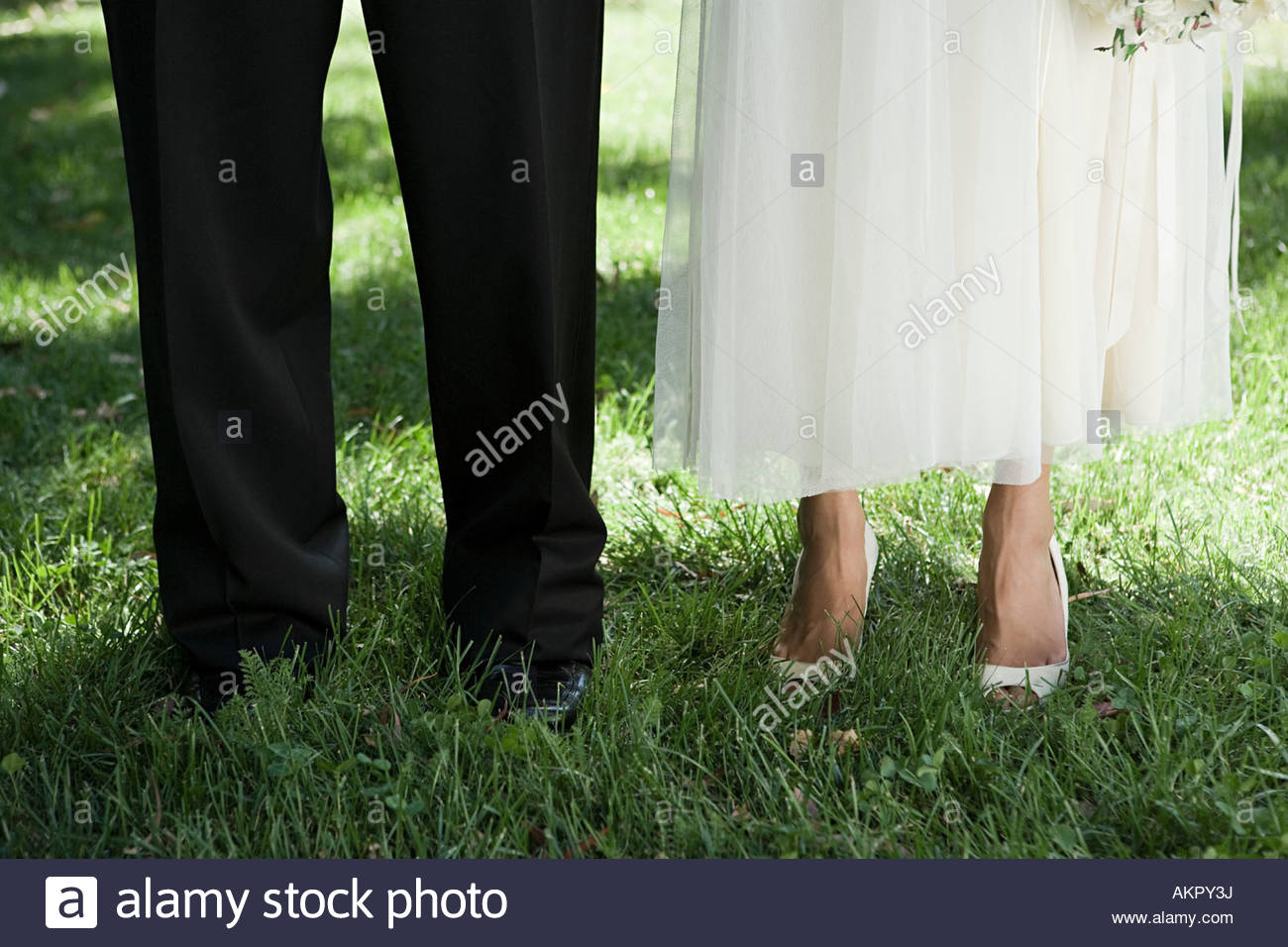 Cropped image of a bride and groom - Stock Image