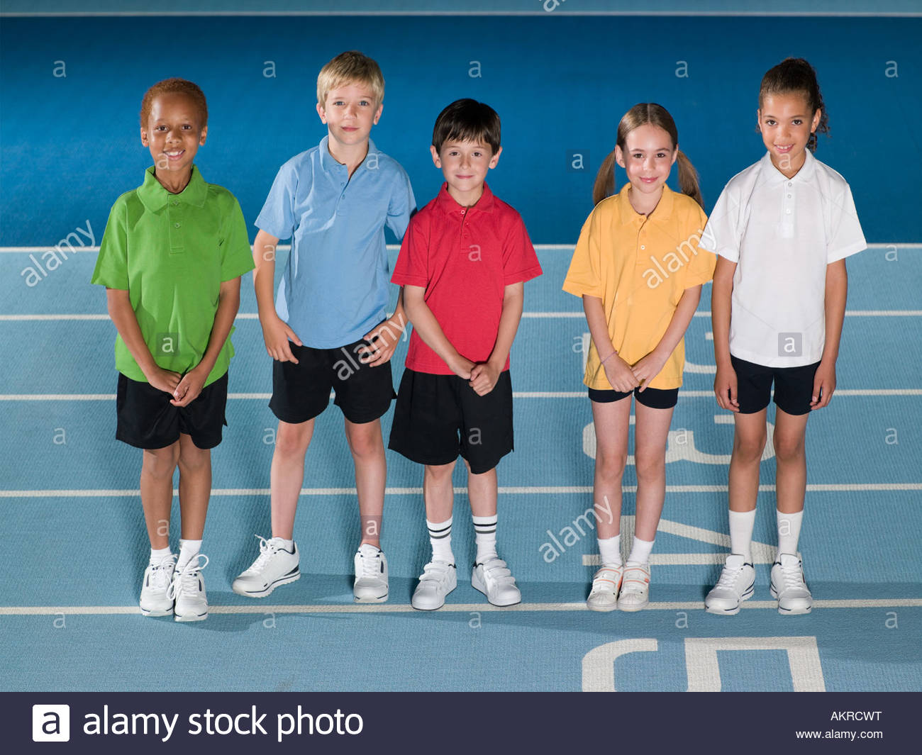 Children on running track - Stock Image