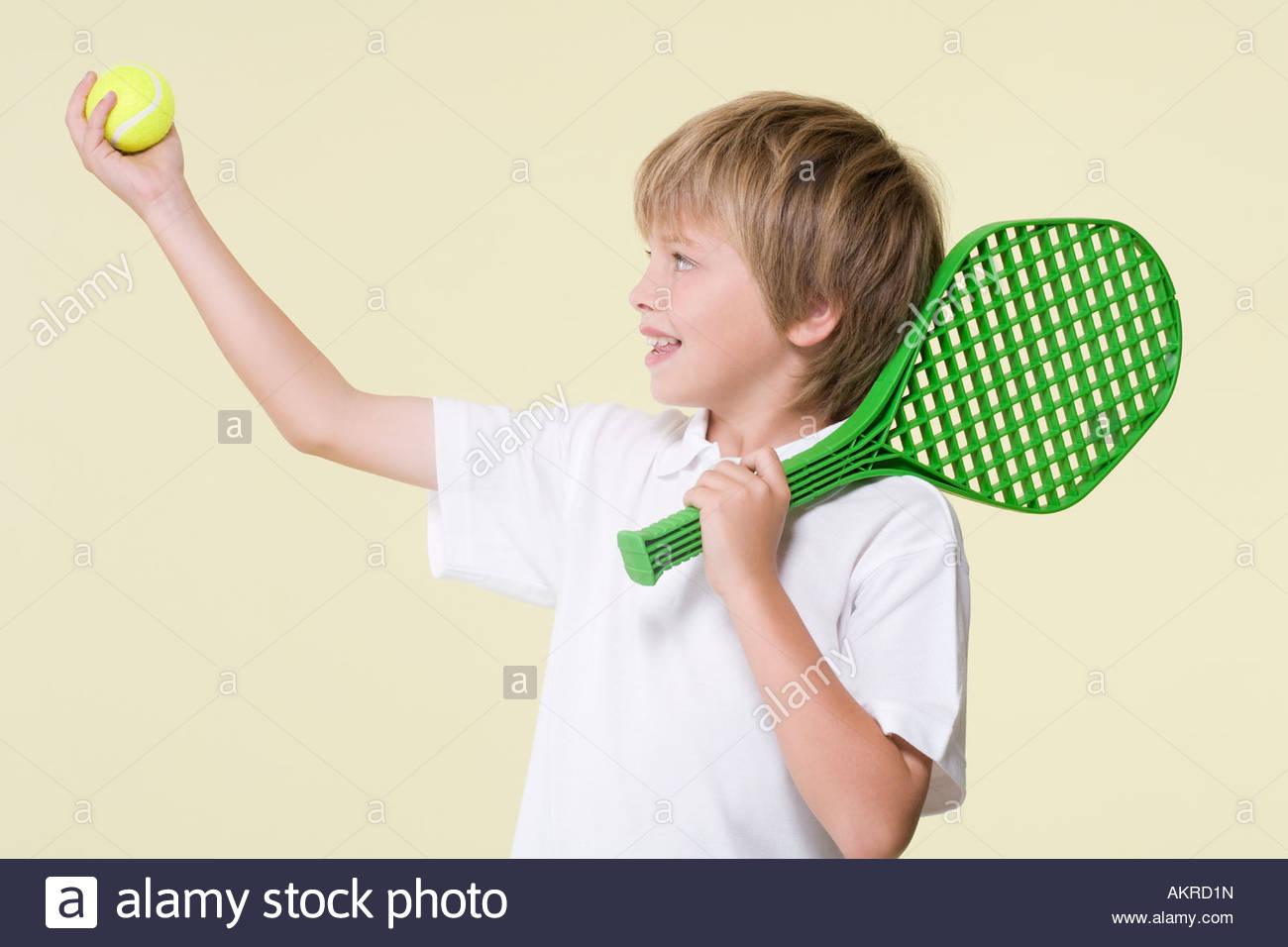 Boy playing tennis Stock Photo