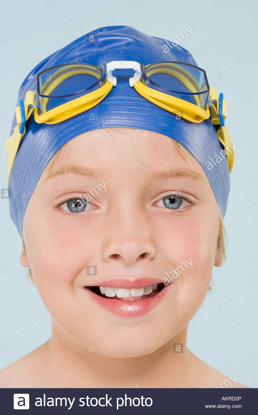 Boy wearing swimming cap and goggles Stock Photo