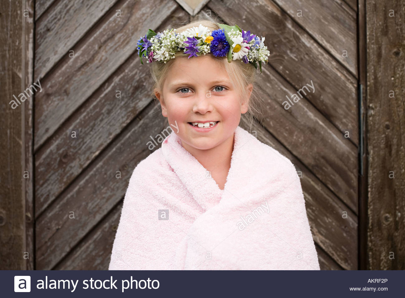 A girl wearing a garland of flowers - Stock Image