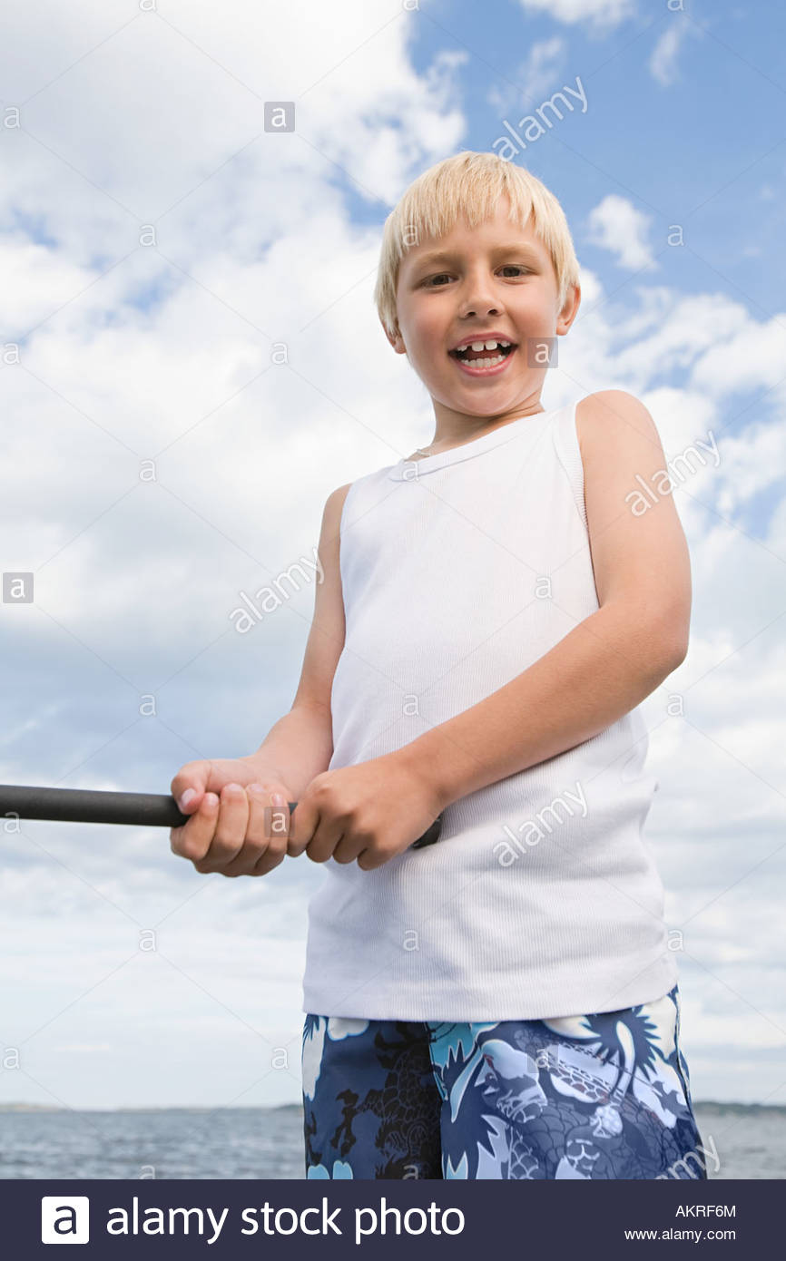 A boy fishing - Stock Image