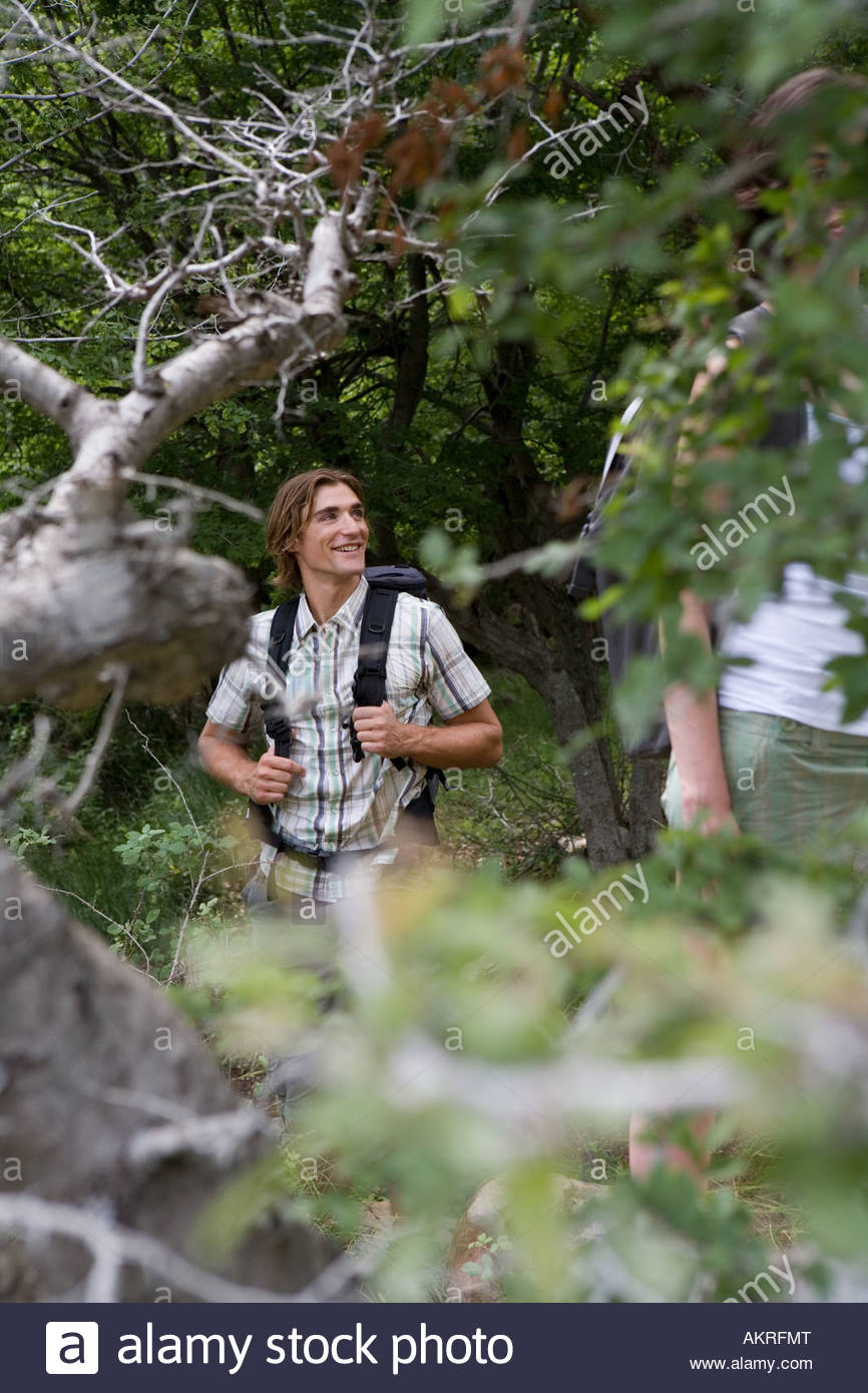 Young man backpacking - Stock Image
