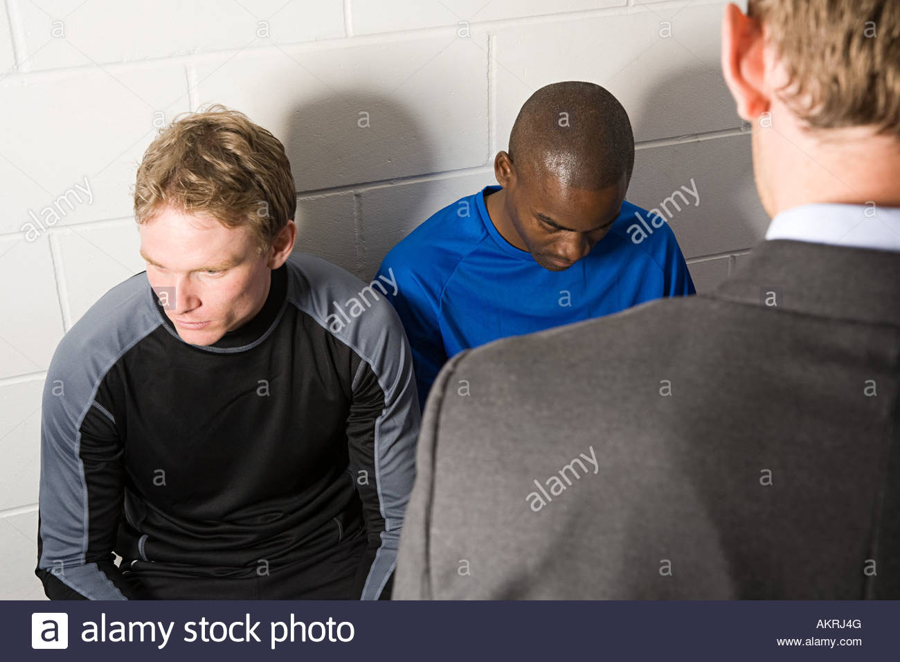 Football manager talking to team - Stock Image