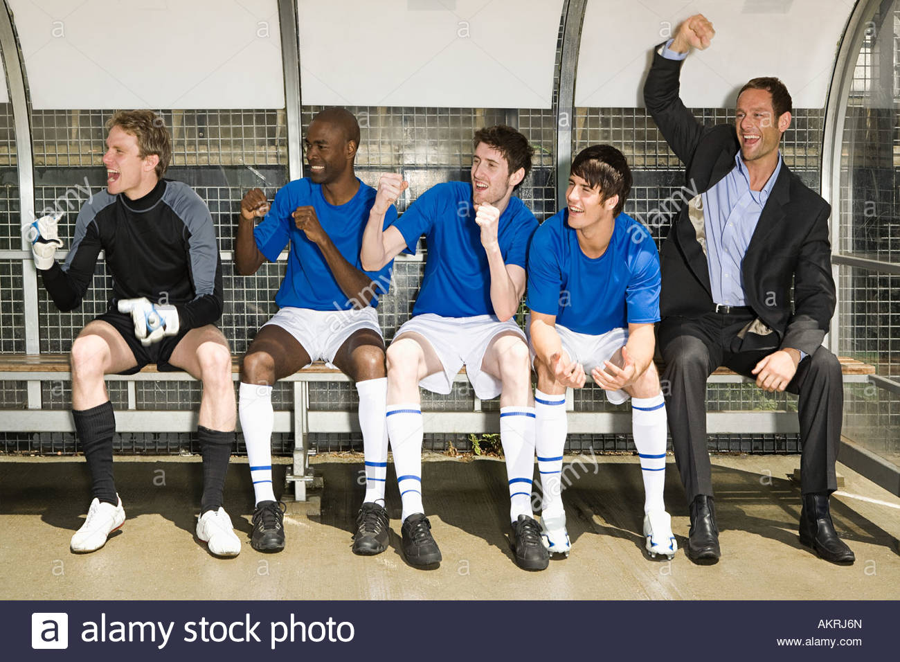 A football team and football manager celebrating - Stock Image