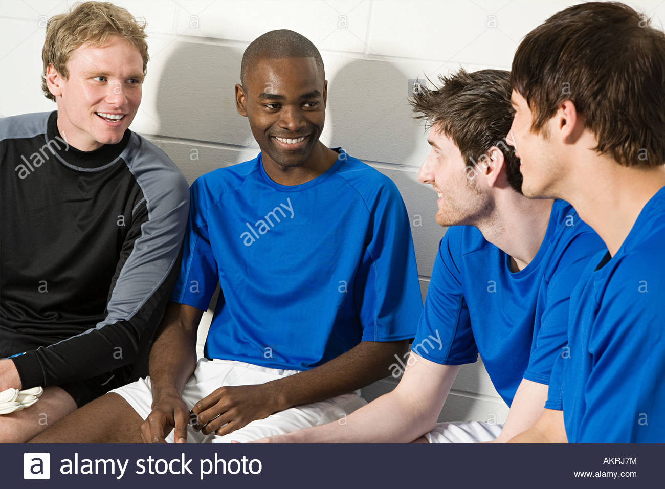 A football team talking in changing rooms - Stock Image