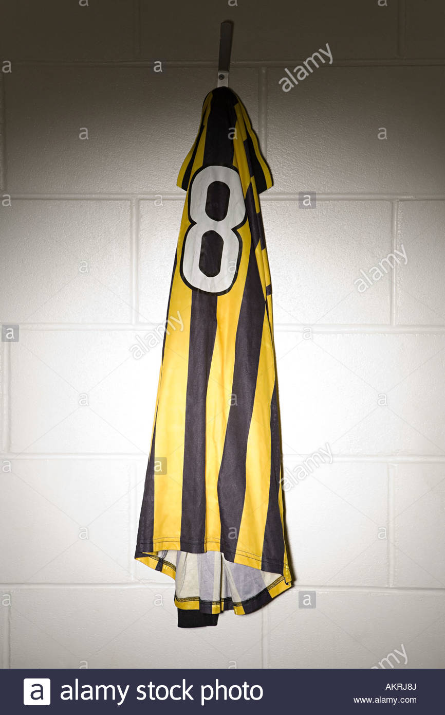A football shirt hanging on a hook - Stock Image