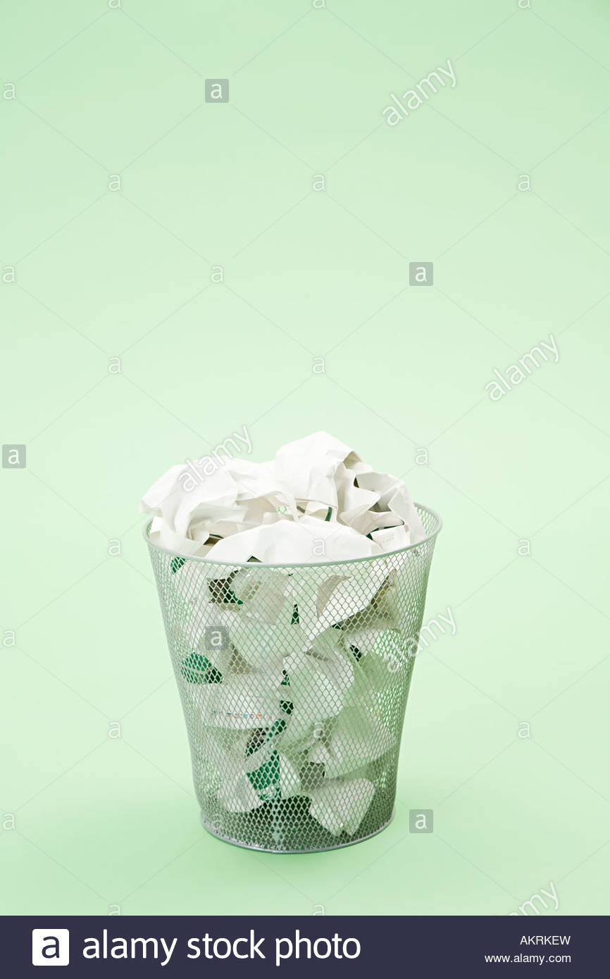 Paper in wastepaper basket - Stock Image