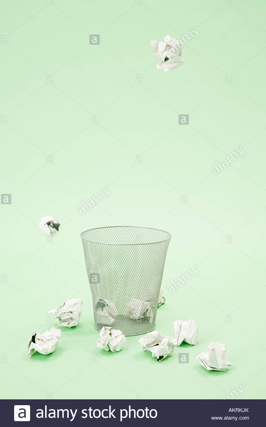 Paper getting thrown into a bin - Stock Image