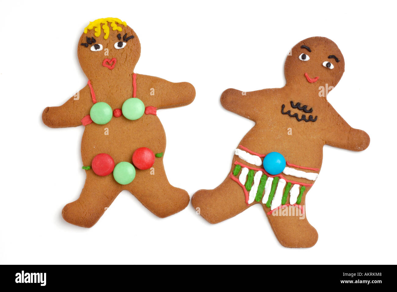 Gingerbread man and woman wearing swimming costumes - Stock Image
