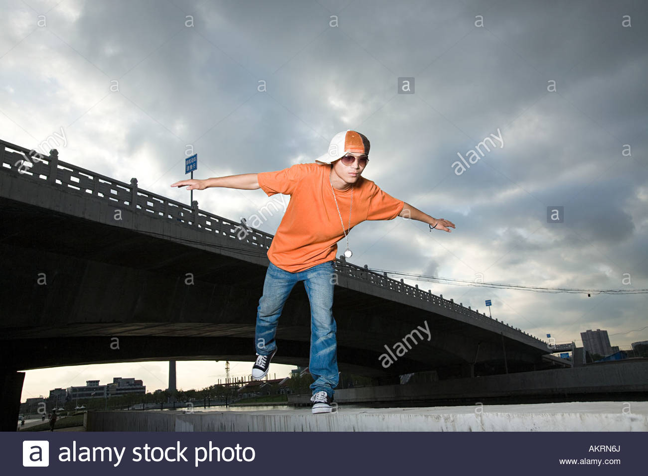 Young man with arms open Stock Photo
