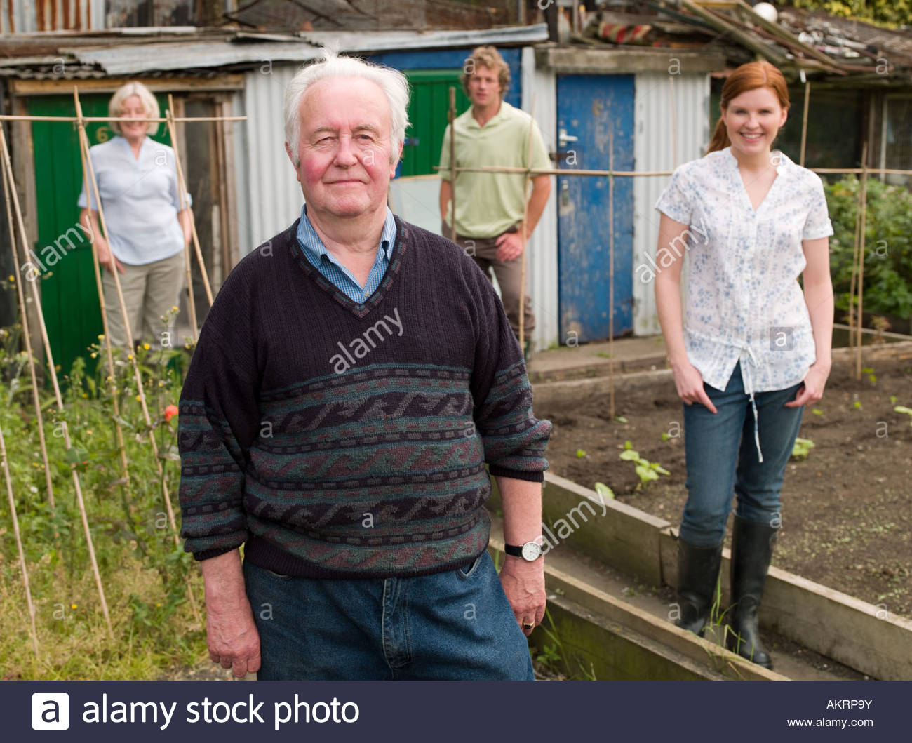 Gardeners stood in their allotment - Stock Image