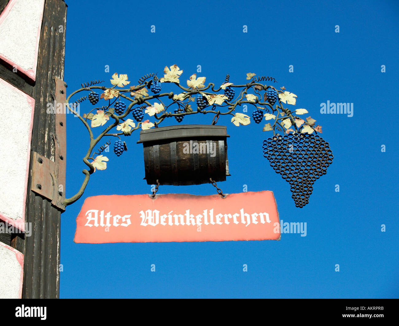 old iron sign for wine celler wine bar in the town Gelnhausen Hesse Germany - Stock Image