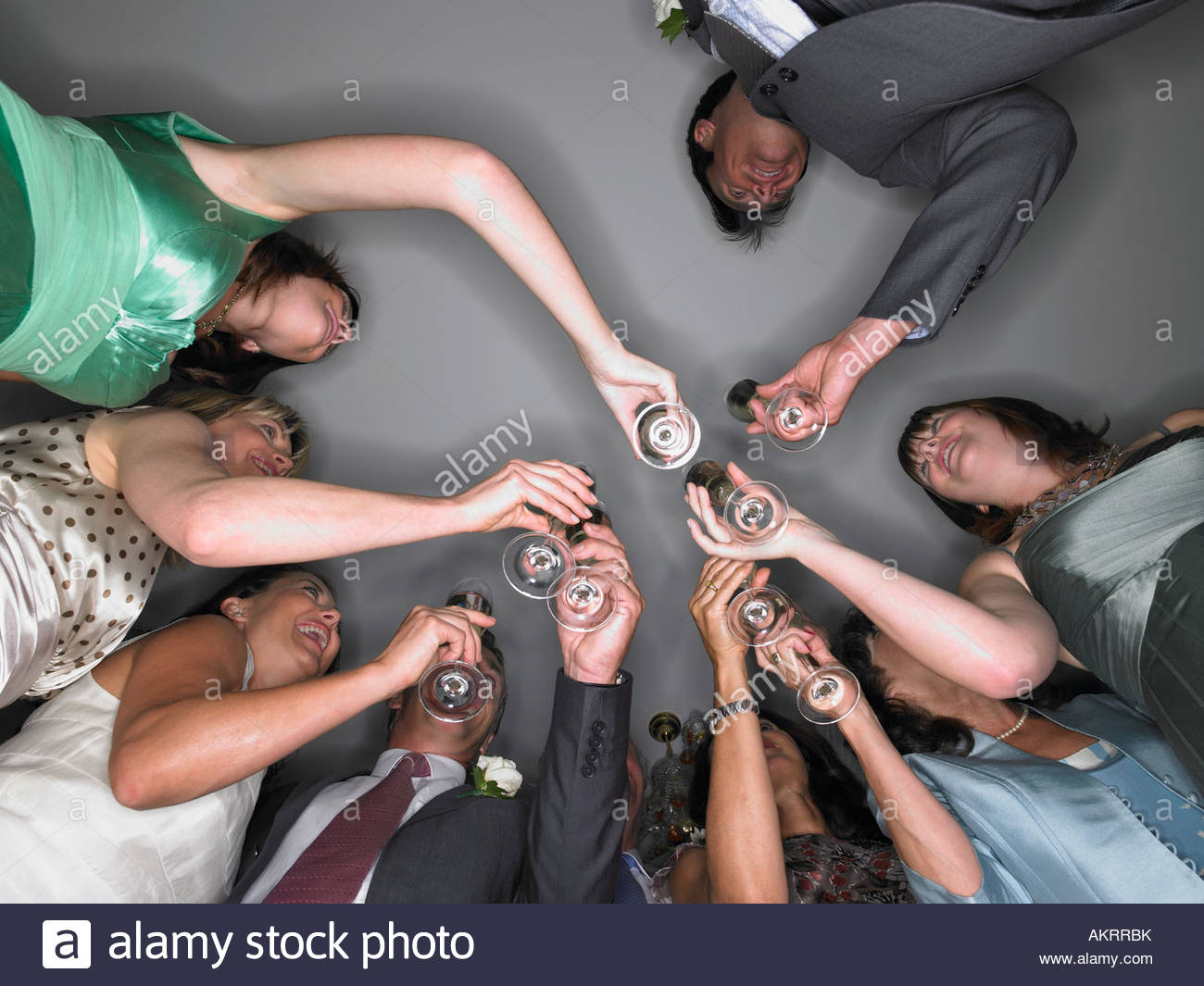 Wedding guests toasting - Stock Image