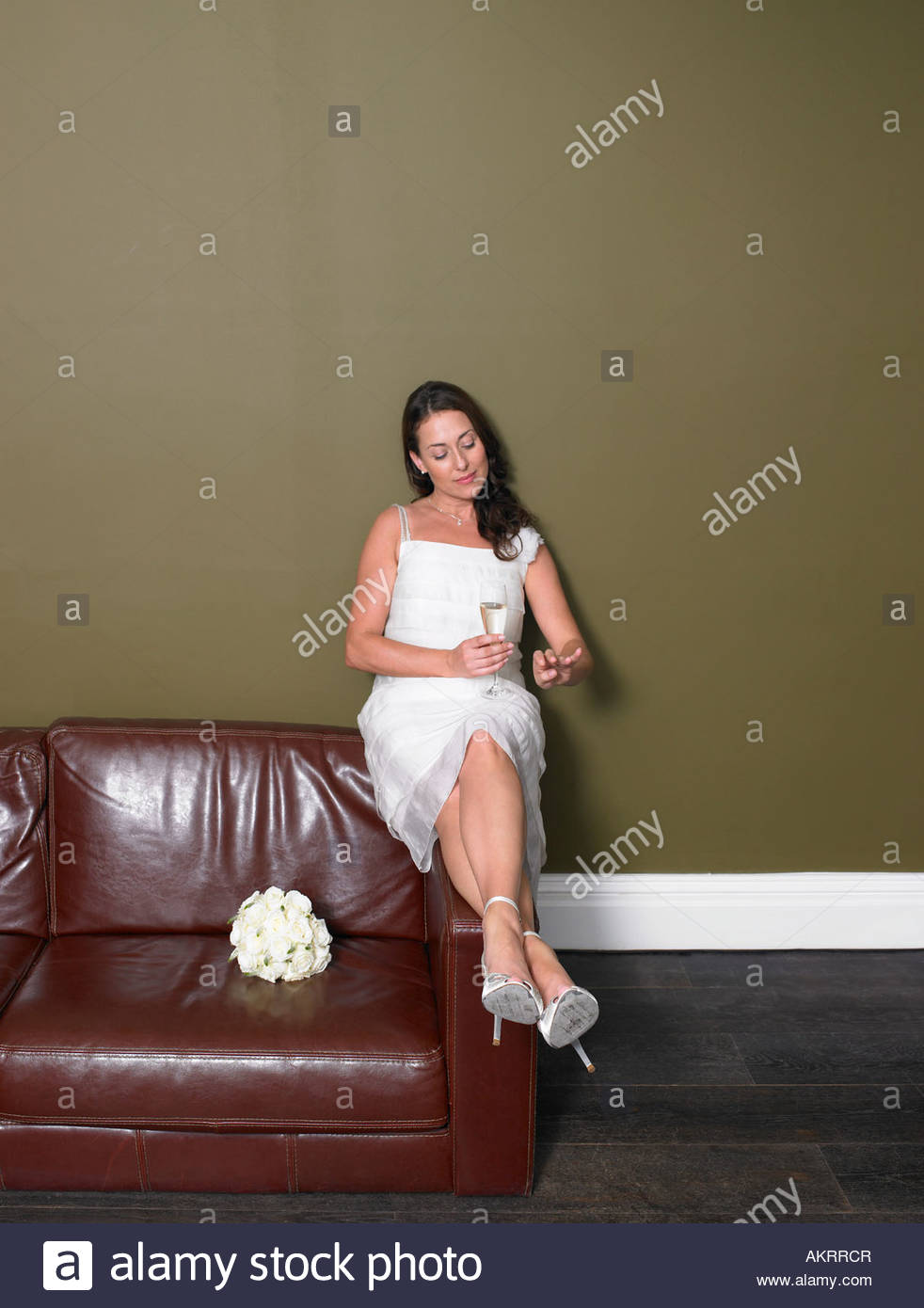 A bride looking at hand - Stock Image