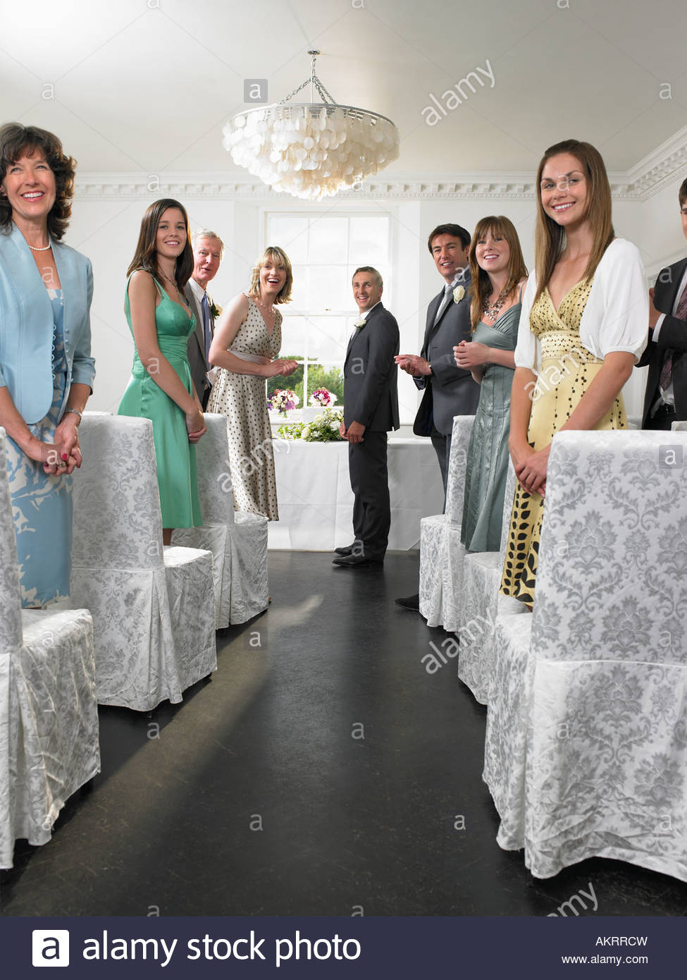Wedding guests looking down aisle - Stock Image