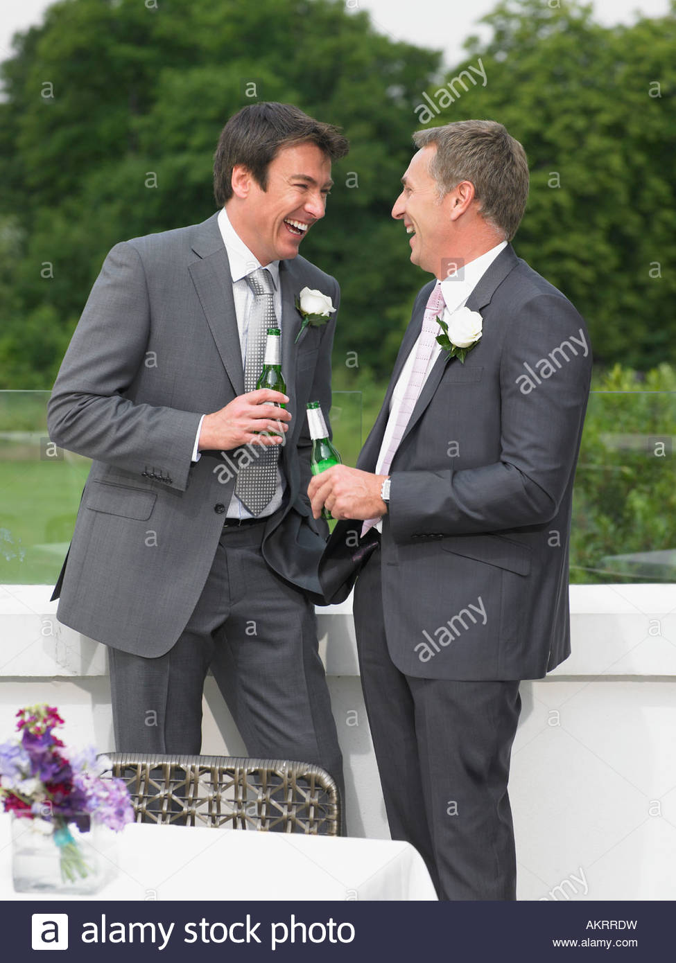 Best man and the groom laughing - Stock Image