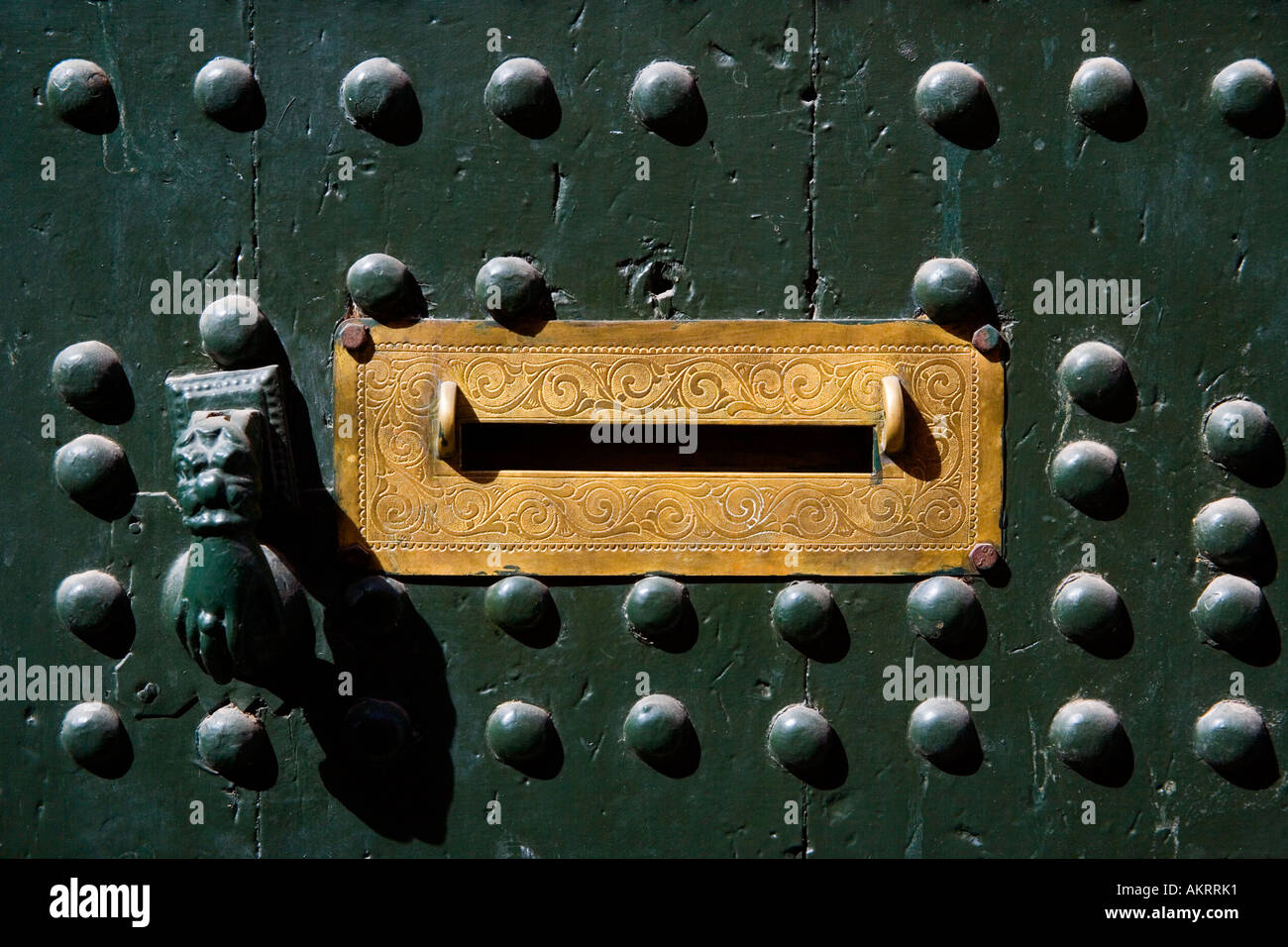 Intricately Tooled Mail Slot with the Hand of Fatima as a Door Knocker, Casbah, Marrakeesh - Stock Image