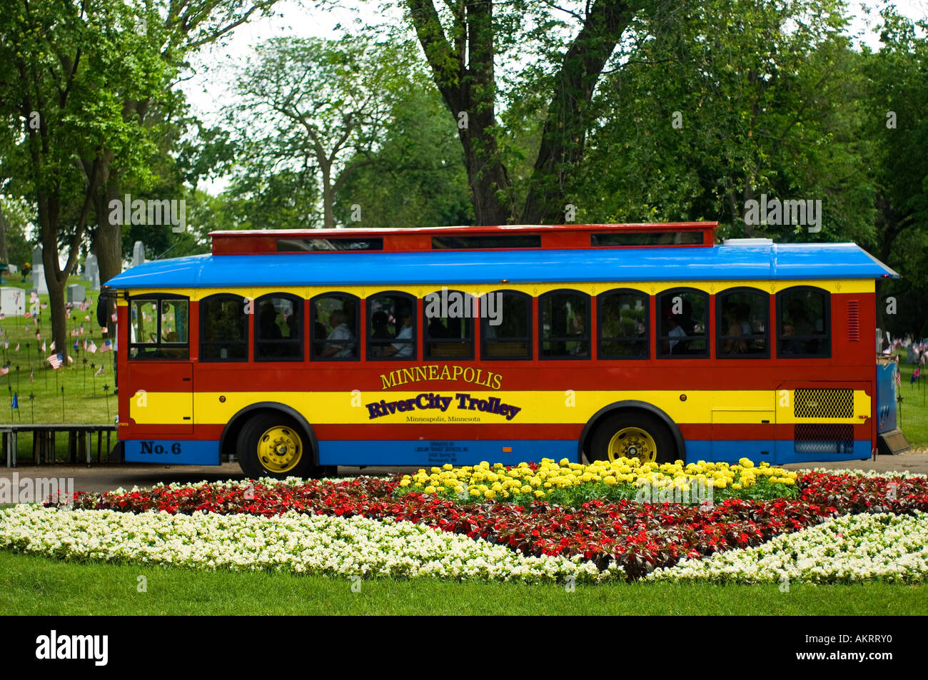 A trolley car in Minneapolis parked behind a flower garden Stock Photo