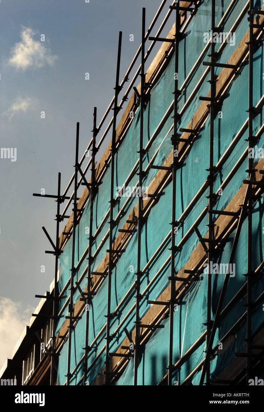A GV of scaffolding surrounding a building on a clear day in central London - Stock Image
