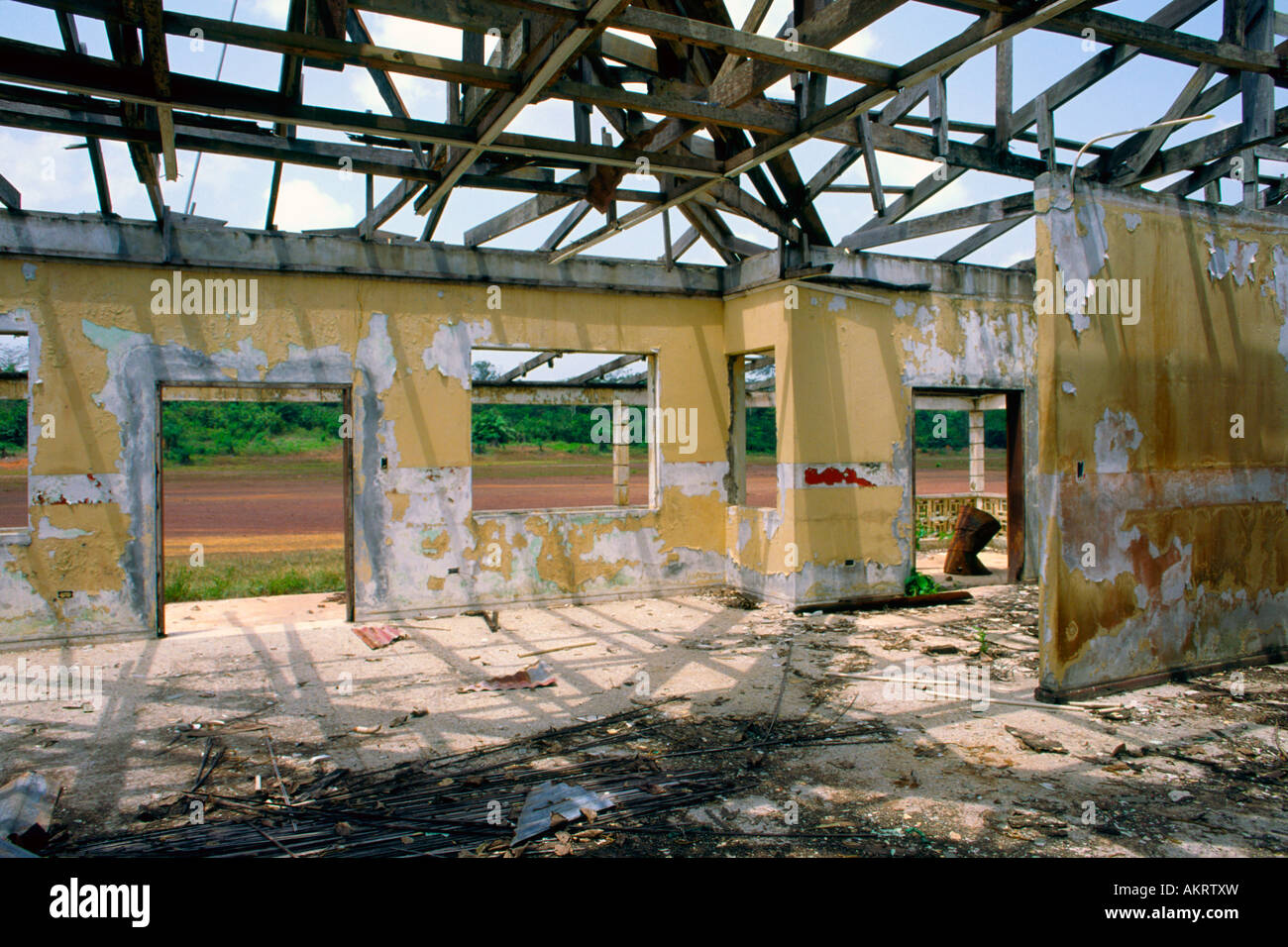 The gutted remains of the terminal building at Zwedru Liberia airport - Stock Image