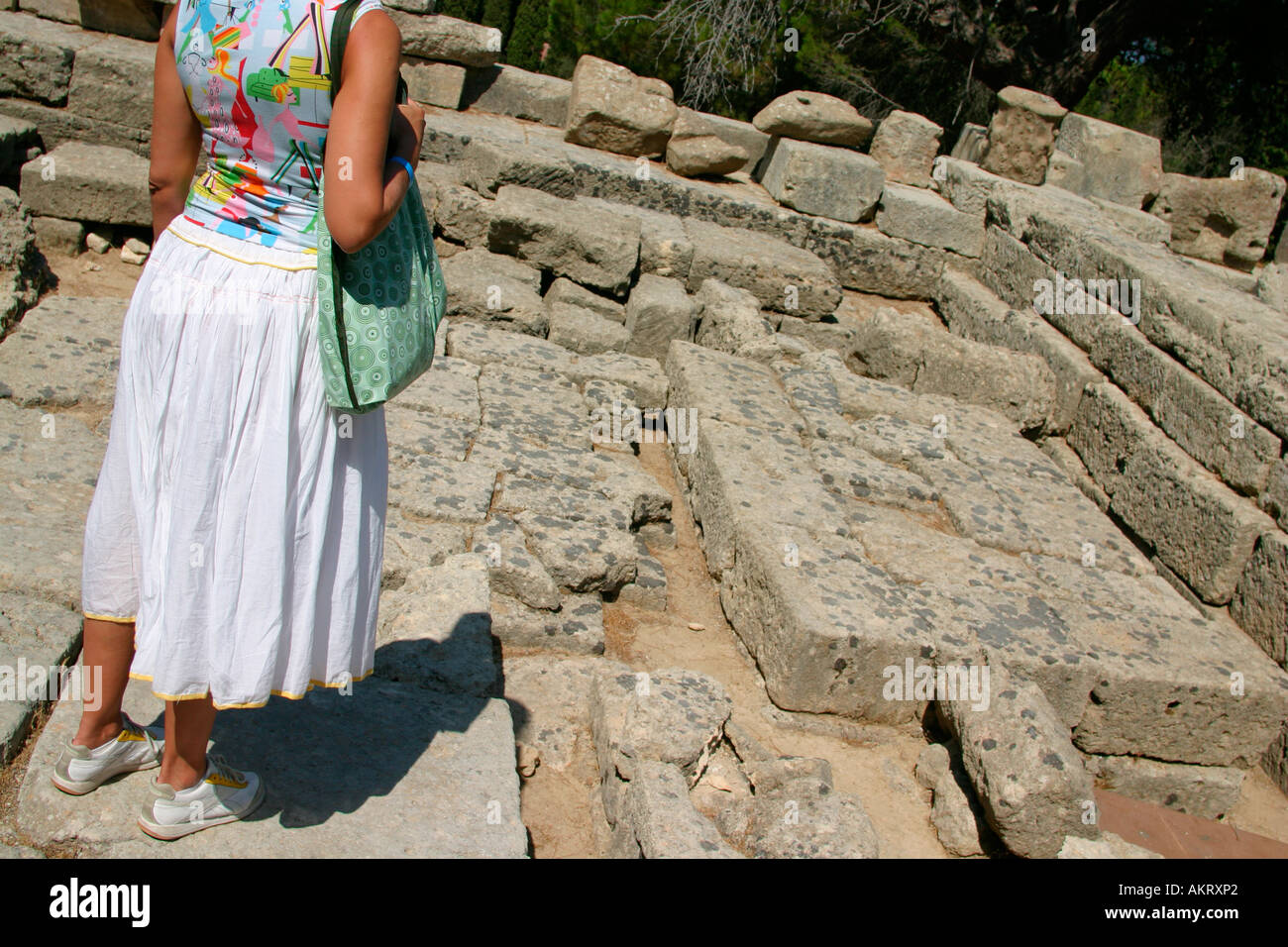 A tourist in front of the Filerimos ruins, Rhodes Island - Stock Image