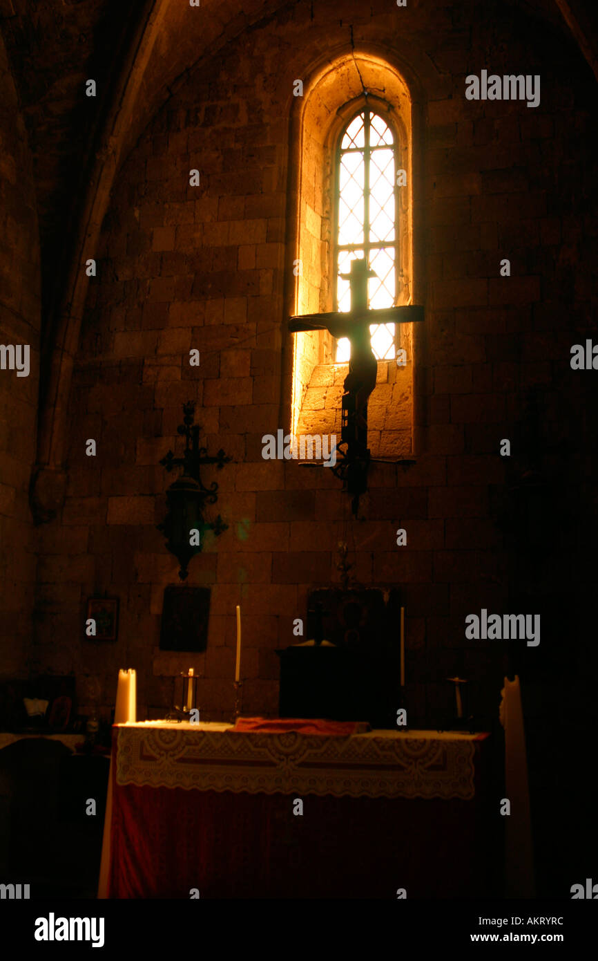 An evocative image of the cross in the little church if Filerimos, Rhodes - Stock Image