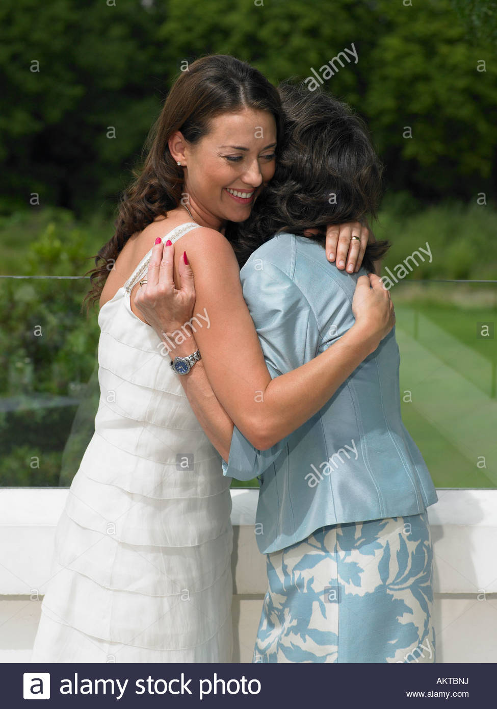 A wedding guest hugging the bride - Stock Image