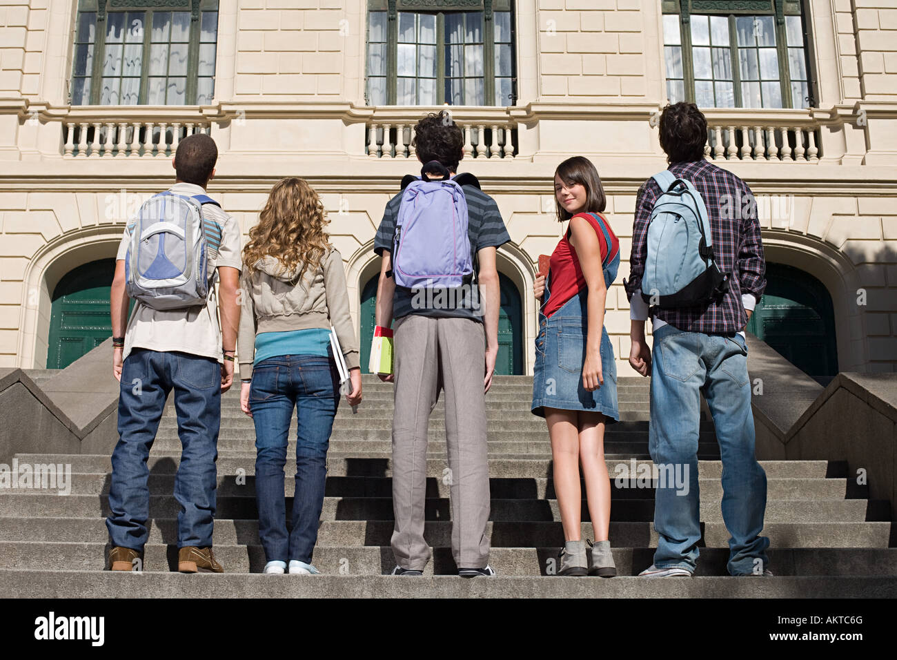 High school students standing on stairs Stock Photo