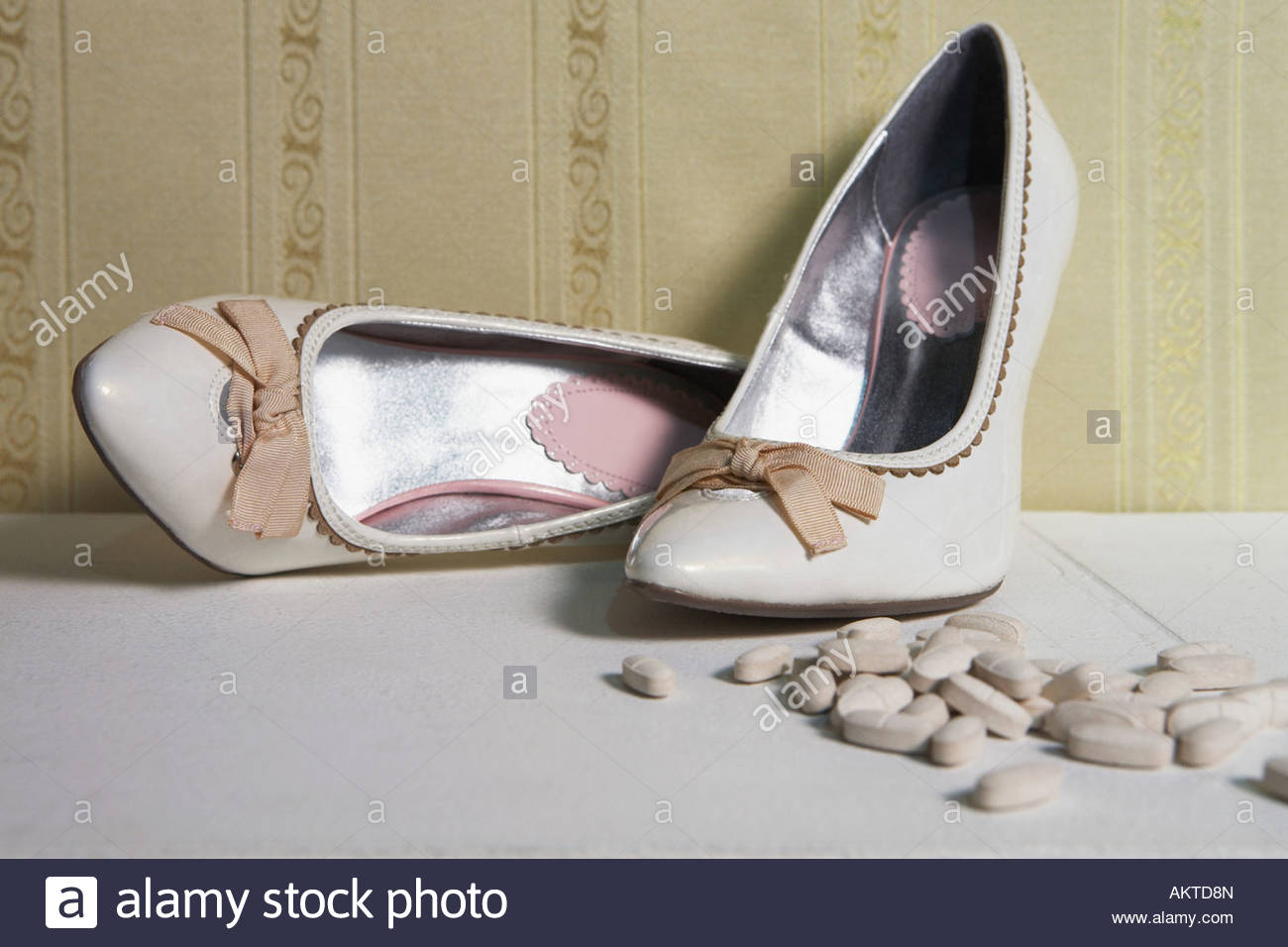 Pair of high heeled shoes and tablets - Stock Image