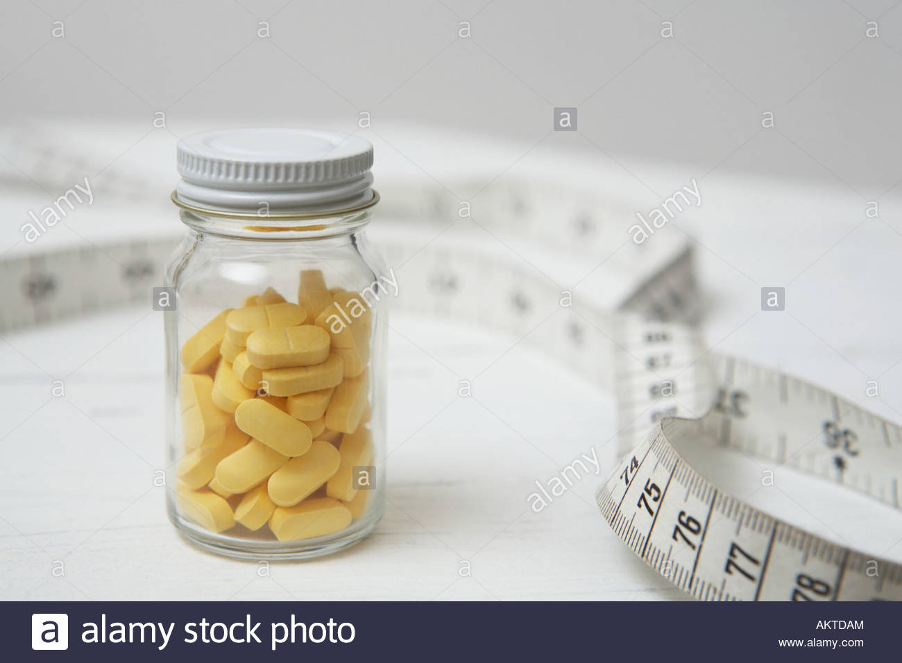 Tablets and a tape measure - Stock Image