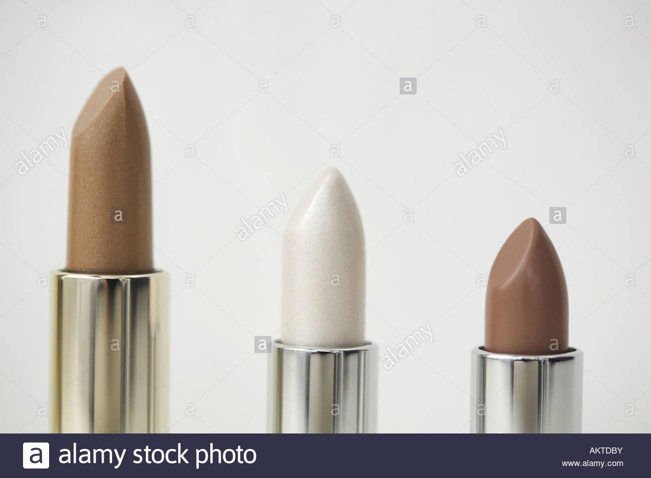 Three lipsticks - Stock Image