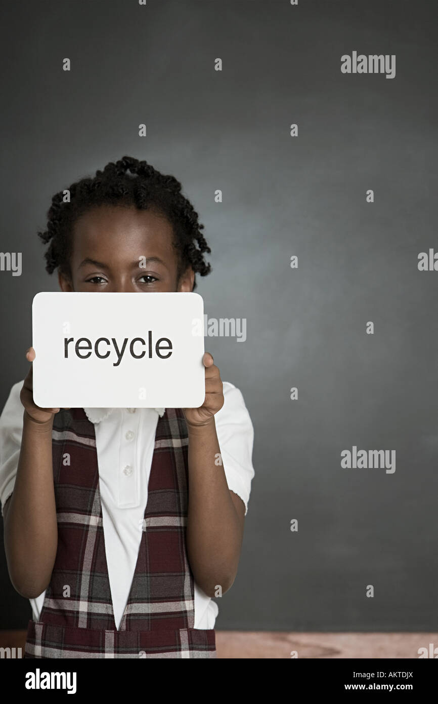 Girl with sign saying recycle - Stock Image