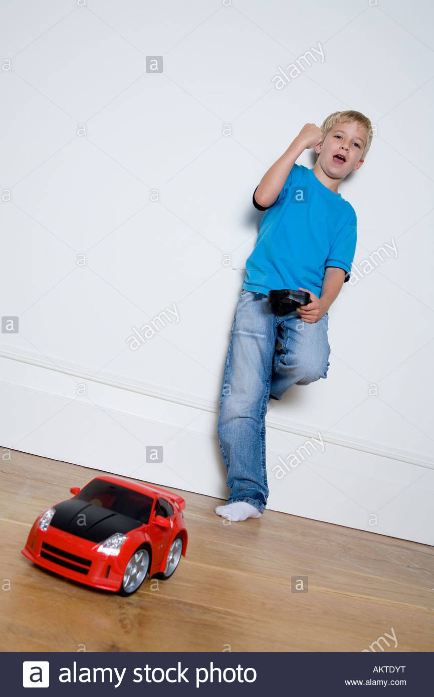 Boy playing with a remote controlled car - Stock Image