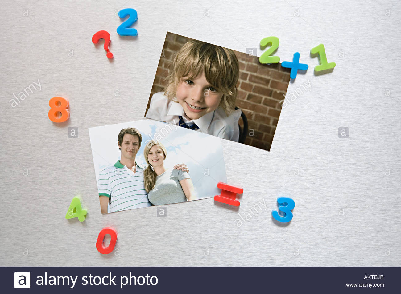 Photos on a fridge Stock Photo