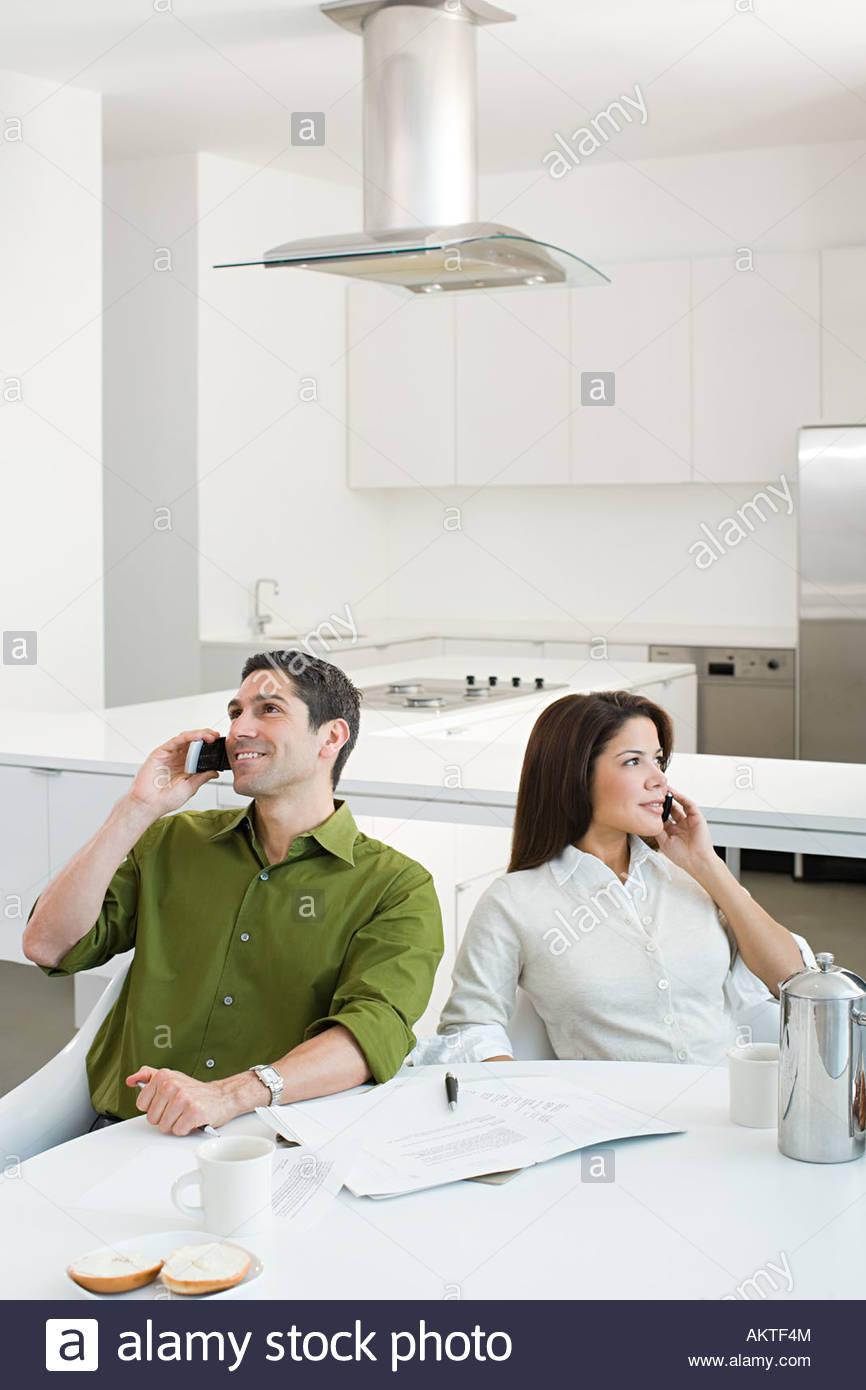Couple using cellular telephones - Stock Image
