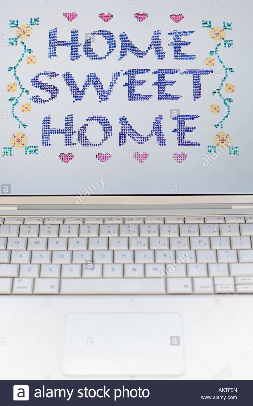 Home sweet home on a computer monitor - Stock Image