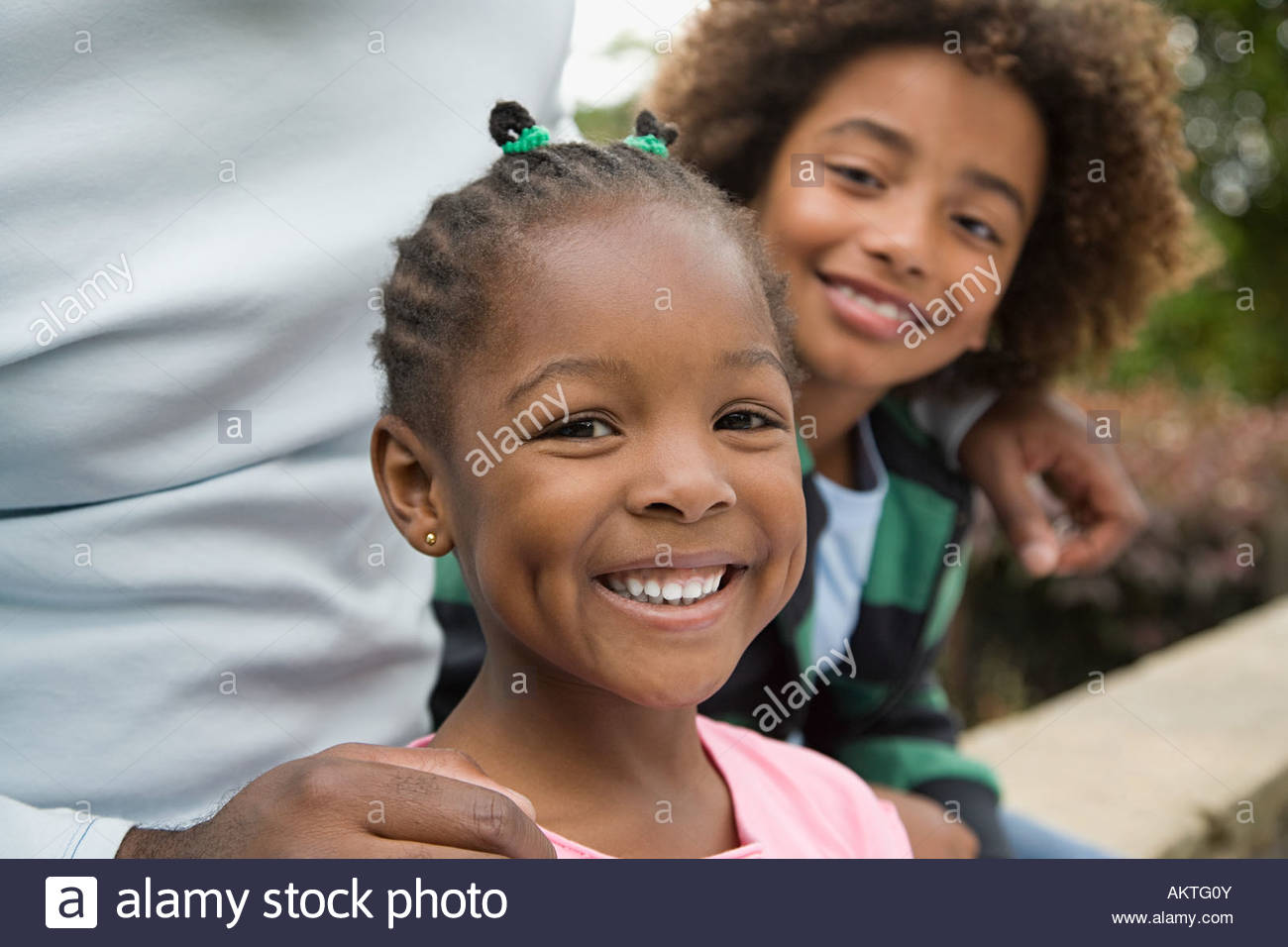 Girl and boy smiling - Stock Image