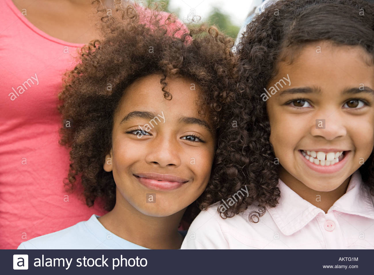 Boy and girl smiling - Stock Image