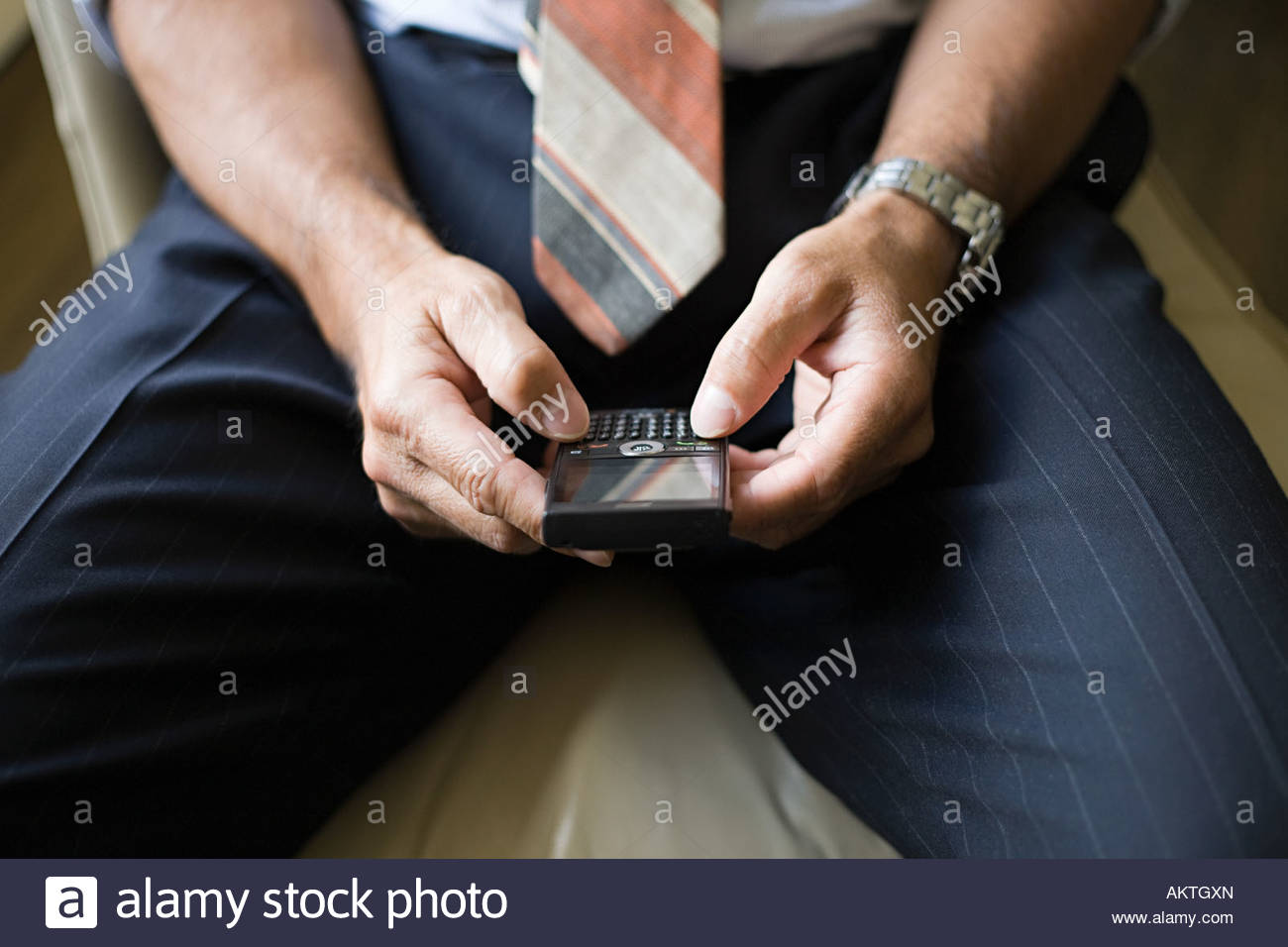 Man with handheld computer - Stock Image