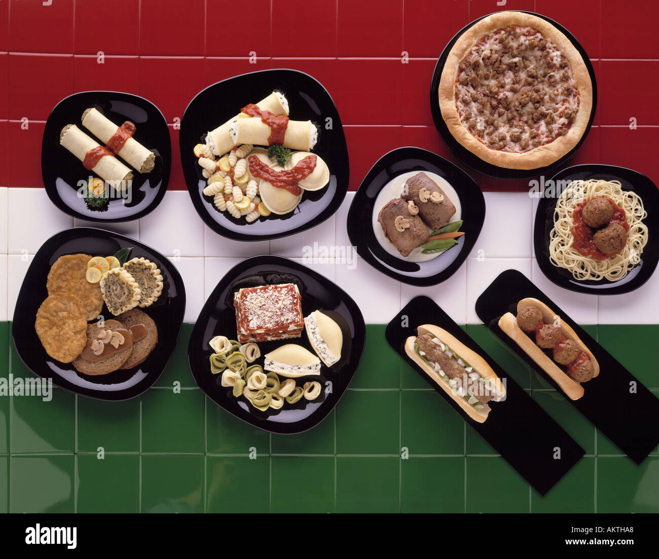 Assortment Italian Foods On Black Dinner Plates Appetizers Red White Stock Photo Alamy