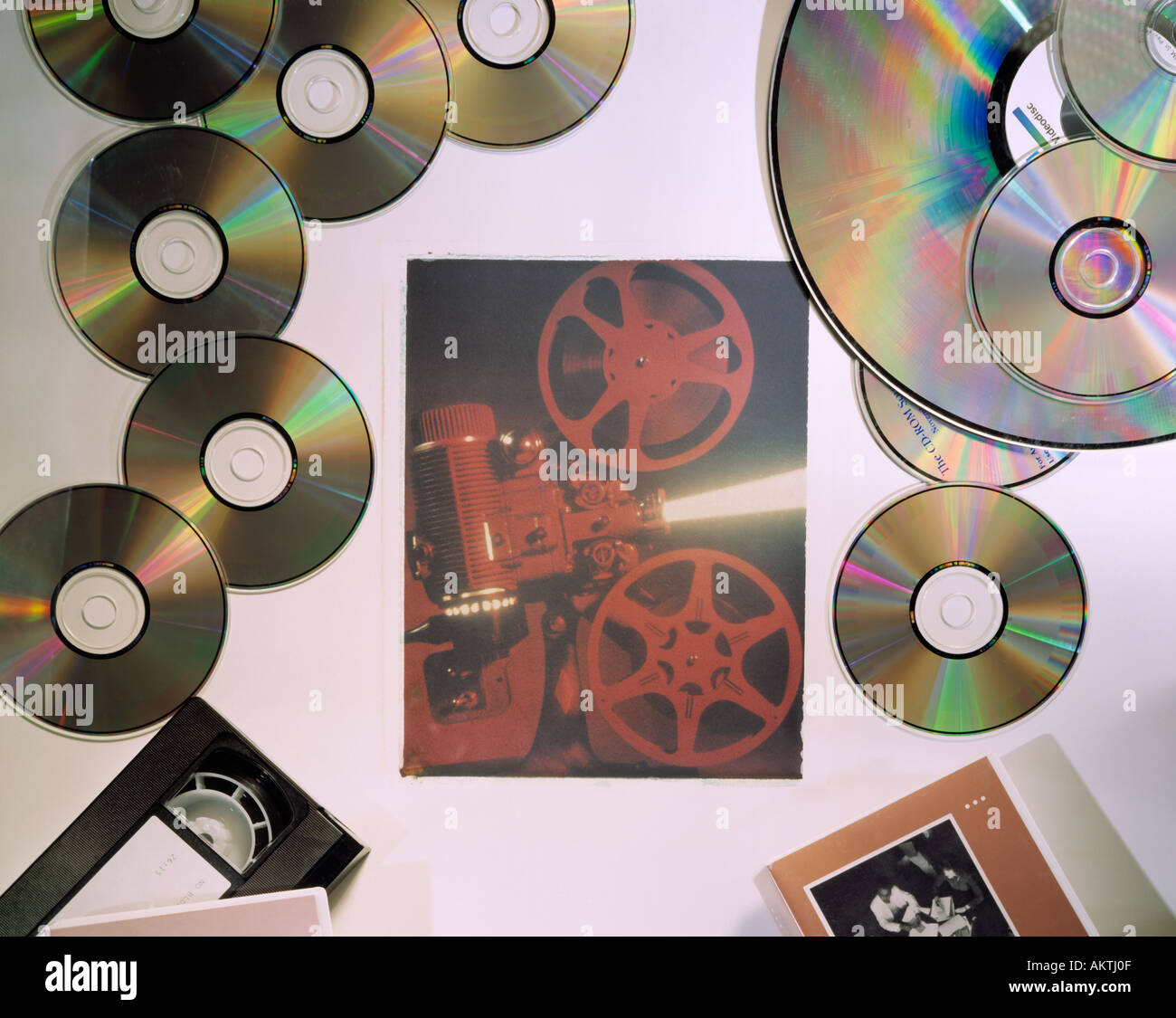 computer digital cd cd s videotape polaroid transfer image of 16mm movie motion picture projector - Stock Image