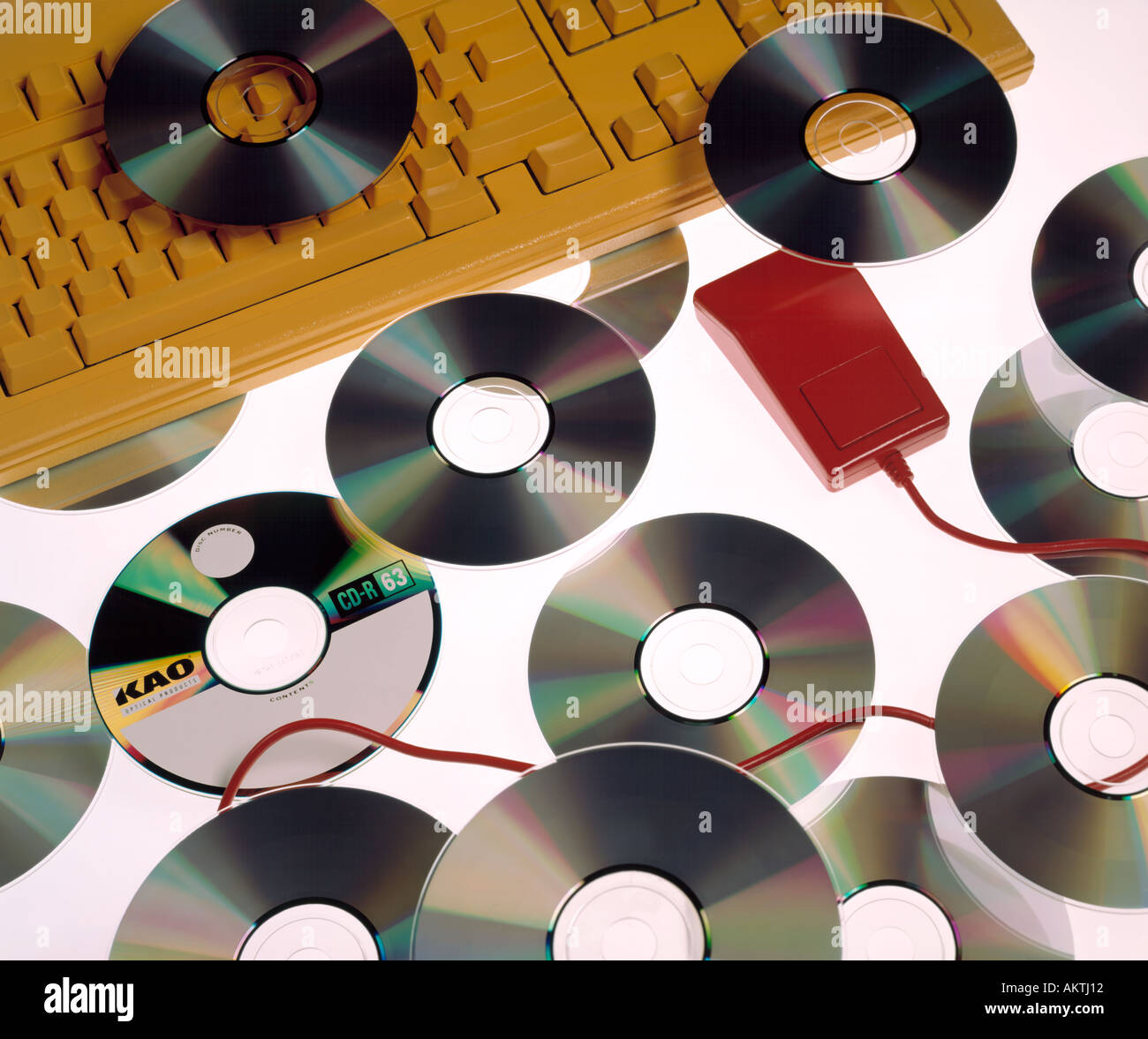 Assortment CD CD s red mouse yellow computer key board keyboard digital - Stock Image