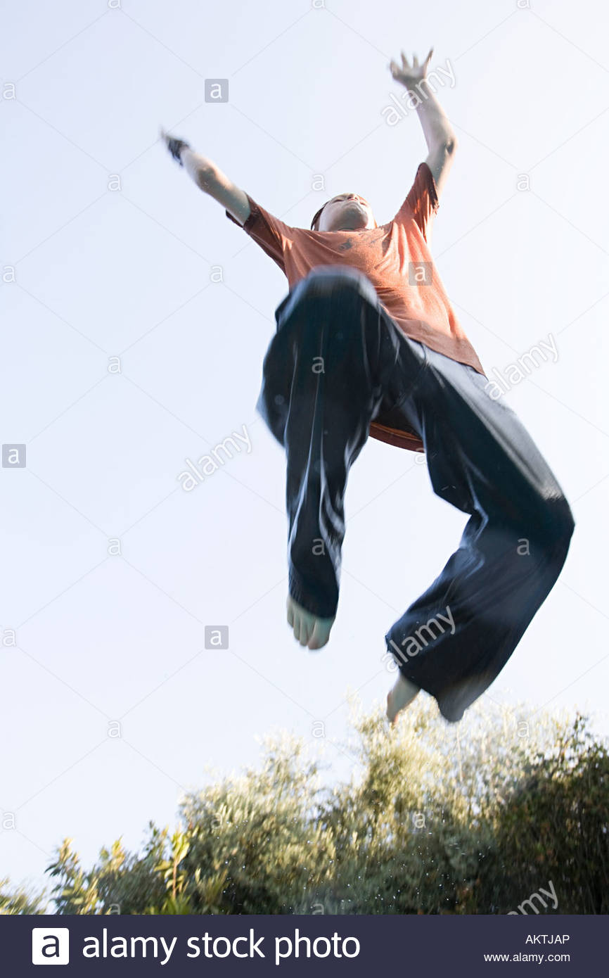 Boy jumping - Stock Image
